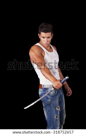 Young warrior holding a ninja sword (isolated on black) - stock photo