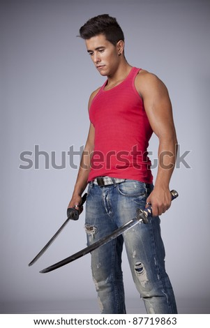 Young warrior with two swords - stock photo