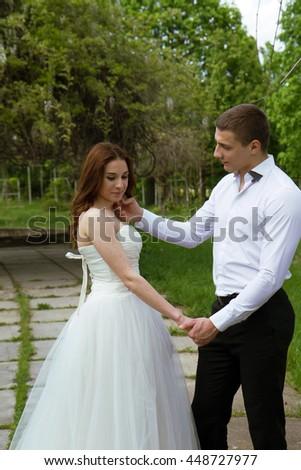 Young wedding beautiful couple enjoying romantic moments - stock photo