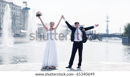 Young wedding couple. At the river bank. - stock photo