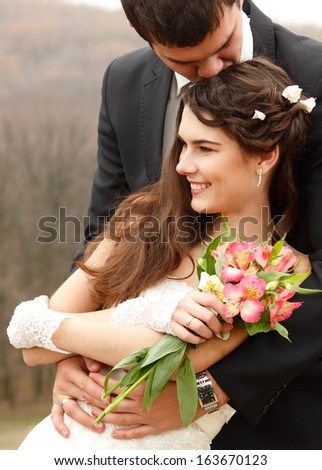 young wedding couple, beautiful bride with groom, autumn nature outdoor - stock photo