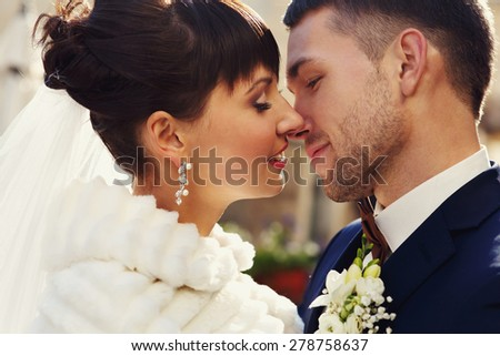 young wedding couple, beautiful bride with groom, autumn nature outdoor, toned and noise added - stock photo