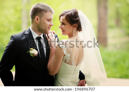 young wedding couple, beautiful bride with groom portrait - stock photo