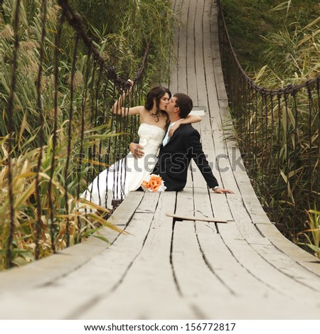 young wedding couple, beautiful bride with groom, summer nature outdoor - stock photo