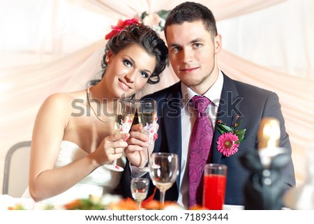 Young wedding couple on party. - stock photo