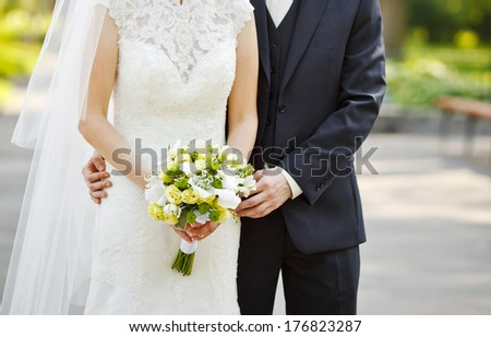 Young wedding couple outdoor. Groom and bride together. - stock photo