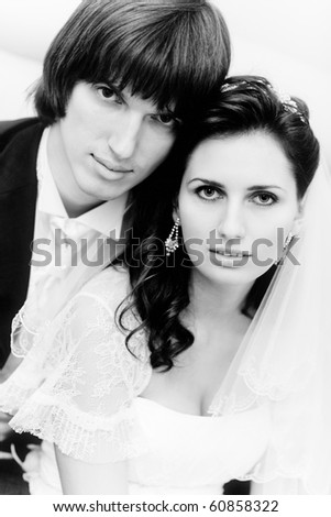 Young wedding couple portrait. Black and white colors. - stock photo
