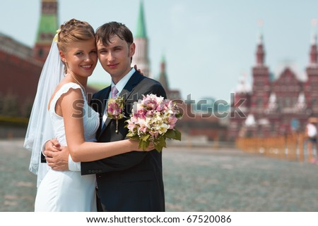 Young wedding couple portrait. On Red Square Moscow Russia. - stock photo