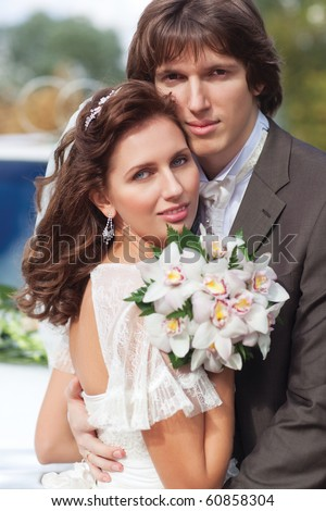 Young wedding couple portrait. Soft colors. - stock photo
