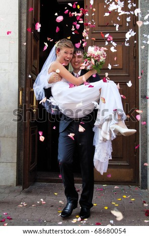 Young wedding couple. Traditional coming out after marriage registration. - stock photo