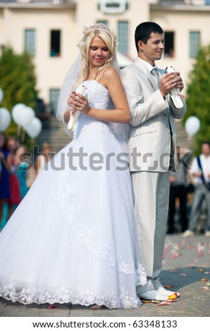 Young wedding couple with white pigeons. - stock photo