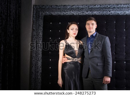 Young White Couple Wearing Elegant Outfits at the Ball, Looking at Camera - stock photo