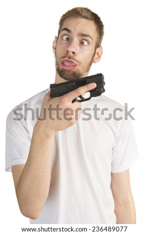 Young white male in his 20s holding a .45 ACP handgun  like a stupid idiot, isolated on white background - stock photo