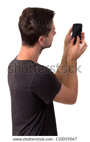 Young White Man In Black T-Shirt Working On His Smartphone - stock photo