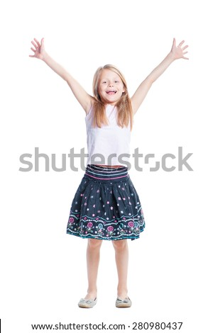 Young winner. Full length of happy young little girl celebrating, gesturing, keeping arms raised and expressing positivity. Isolated on white. - stock photo
