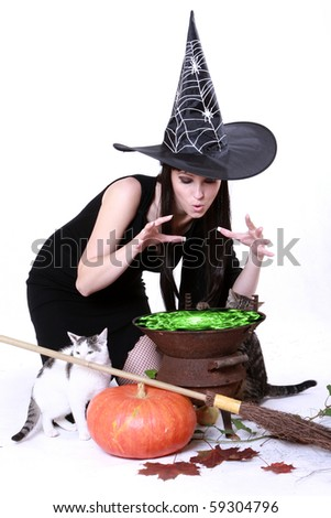 young witch on halloween night - stock photo