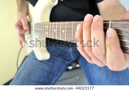 Young with guitar and an amplifier - stock photo