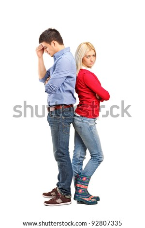 Young with their backs turned after having an argument isolated on white background - stock photo