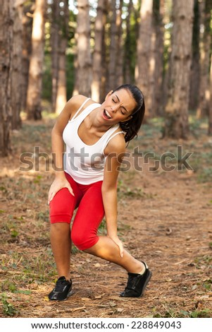 Young woman after running had injuries  - stock photo