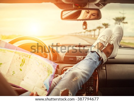 Young woman alone car traveler with map - stock photo