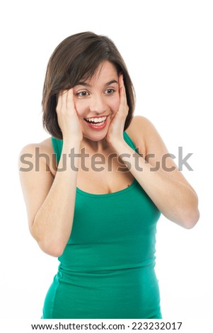 Young woman amazed and holding her face with her hands, isolated on white - stock photo