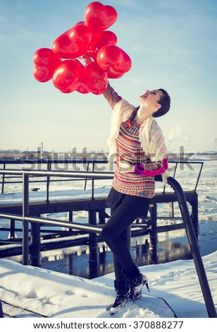 Young woman and balls hearts - stock photo