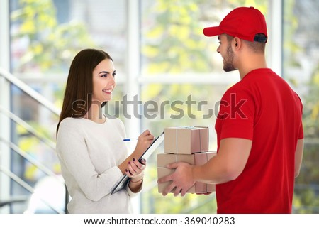 Young woman and courier - delivery concept - stock photo