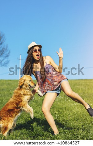 young woman and golden retriever enjoying in the nature - stock photo