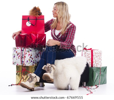 Young woman and her Pomeranian on christmas - stock photo