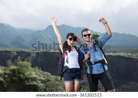 young woman and man couple go trekking together, nature background - stock photo