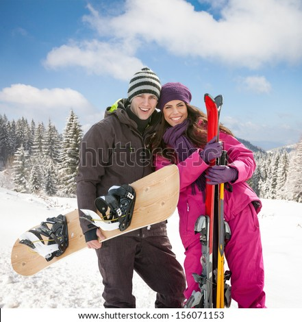 young woman and man skiers on winter day - stock photo