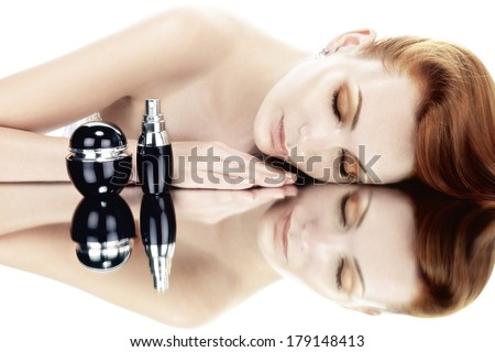 young woman and skincare products on white  - stock photo