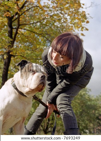 Young woman and strong dog - stock photo