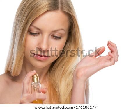 Young woman applying perfume on hand - stock photo