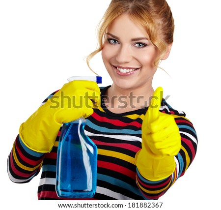 Young woman as a cleaning maid holding  liquids and showing OK sign, isolated over white  - stock photo