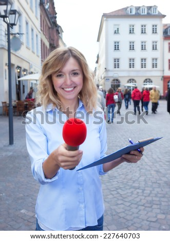 Young woman asking for opinion in the city - stock photo