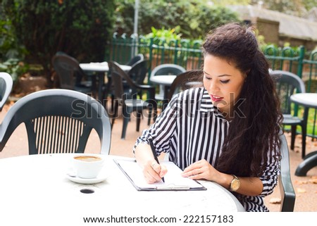 young woman at a coffee shop.  - stock photo