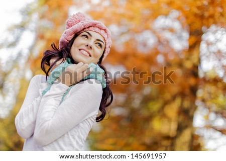 Young woman at autumn forest - stock photo