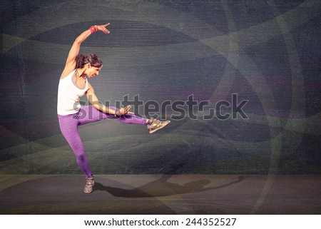 young woman at fitness exercise or fitness dancing - stock photo
