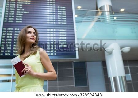 Young woman at the airport - stock photo