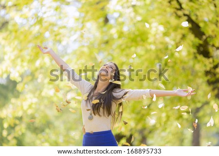Young woman at the autumn park - stock photo