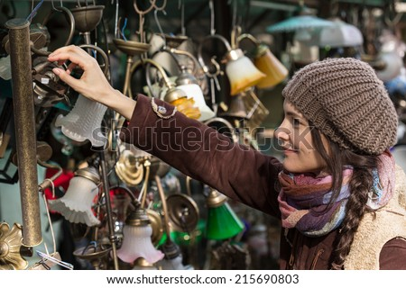 Young woman at the flea market - stock photo
