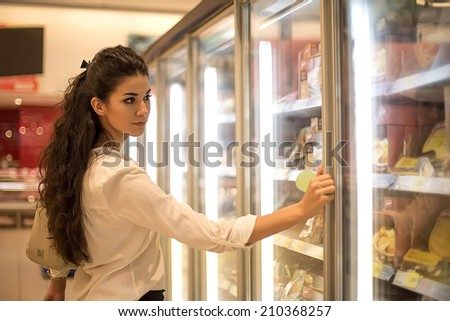 Young woman at the store - stock photo