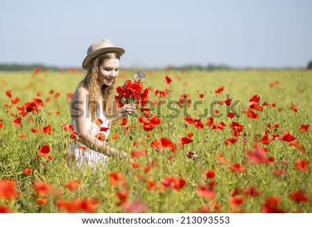 Young woman at white dress search beatiful flower - stock photo