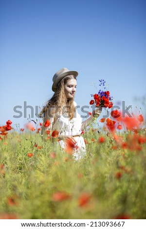 Young woman at with bouquet at sky background - stock photo