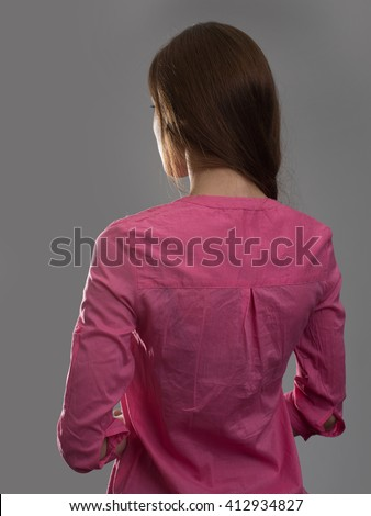 young woman back view. Dark gray background - stock photo