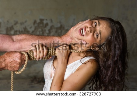 Young woman being abused trying to defend herself - stock photo