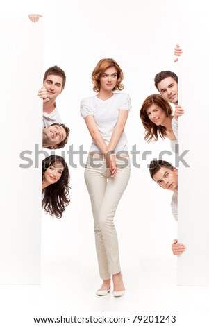 young woman between two blank boards and friends - stock photo