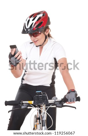 Young woman biker with her bike isolated over white background looking at the phone - stock photo