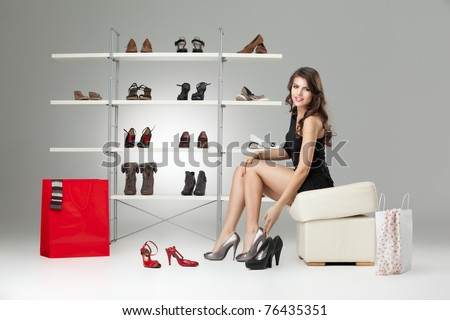 young woman black dress shoes stand high heels - stock photo